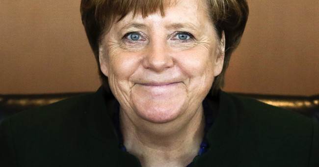 Merkel's party wins in key state vote, exit polls show