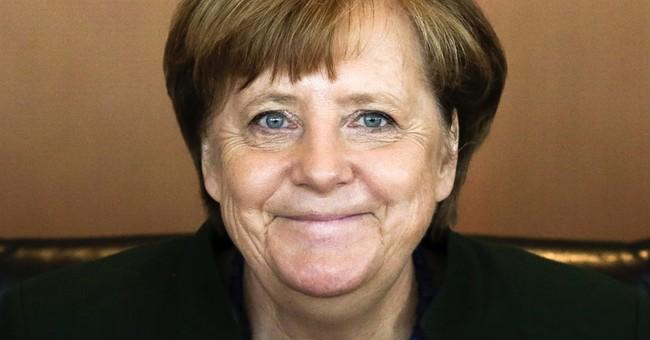 German state vote shows Merkel on track