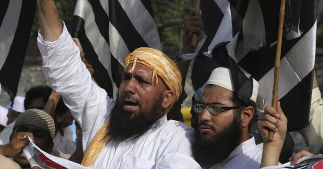 Pakistanis protest IS attack against pro-Taliban politician