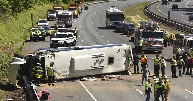 Bus carrying 26 kids on DC field trip overturns on I-95