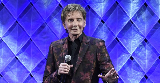 Barry Manilow postpones 2 shows to rest vocal cords