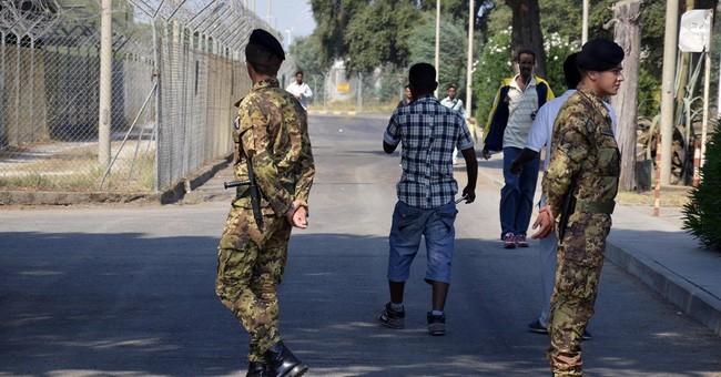 Italian police: Mafia skimmed millions from migrant funds