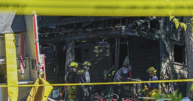 The Latest: Family says 2 adults, 5 children died in fire