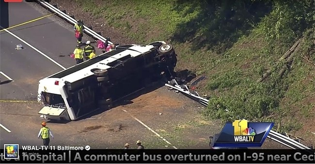 The Latest: Police: Kids on DC field trip on overturned bus
