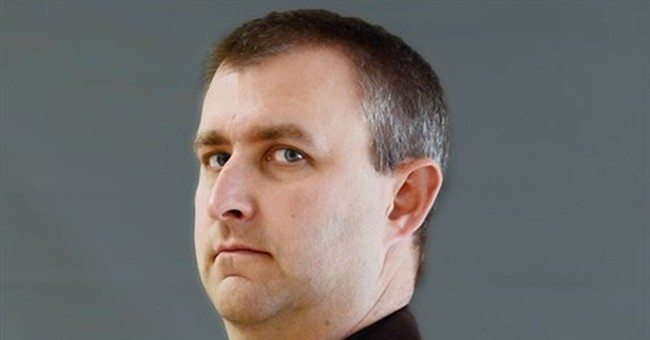 The Latest: Deputy's body escorted to hospital for autopsy