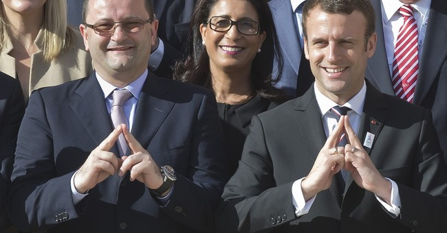 French president pushes Paris Olympic bid, vets ministers