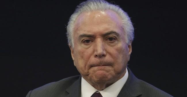 Brazil leader denies report he endorsed bribing ex-lawmaker