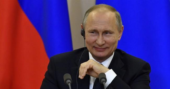 The Latest: Putin says Russia meddling furor is 'nonsense'