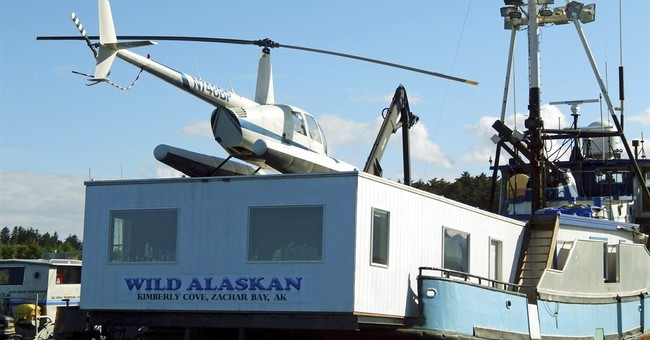 Owner: No flak from the law for floating Alaska strip club