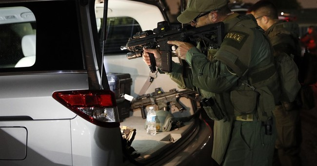 The Latest: MS-13 gang targeted in sweep across Los Angeles