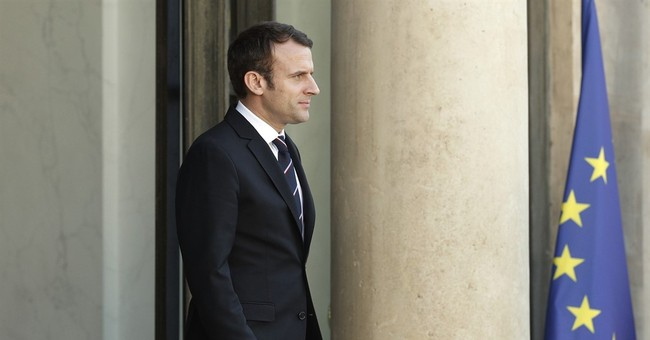 The Latest: Macron's 18-member Cabinet has old, new faces
