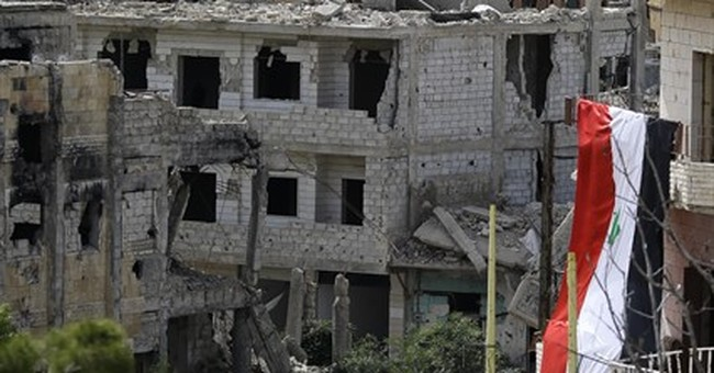 US airstrike hits pro-Syria government forces for first time