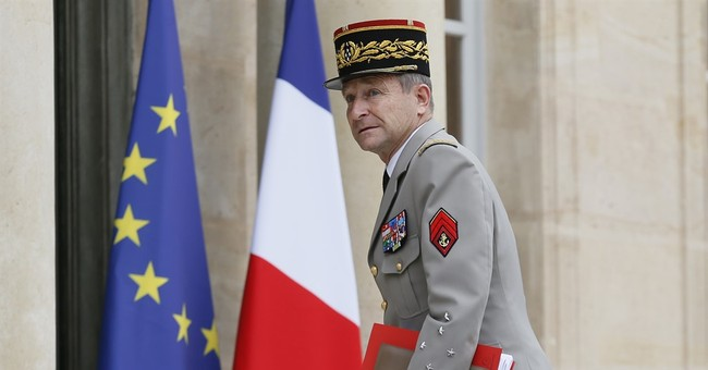 The Latest: Trip to bring Macron face-to-face with troops