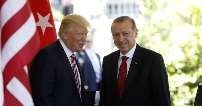 The Latest: Turkish melee in Washington left injuries, shock