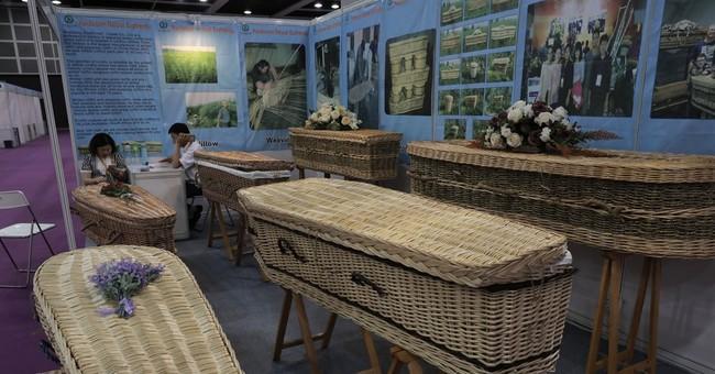 Asian funerals go green, high-tech at Hong Kong trade fair