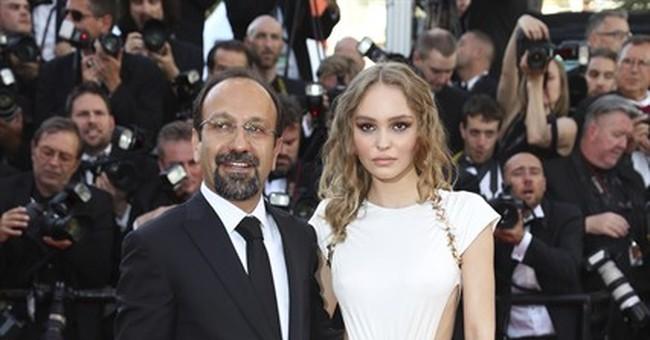 Iran's Asghar Farhadi collects Oscar at Cannes after boycott