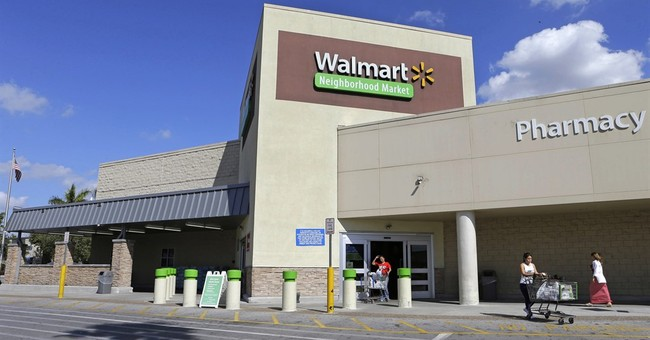 Wal-Mart sees online sales surge, more shoppers at stores