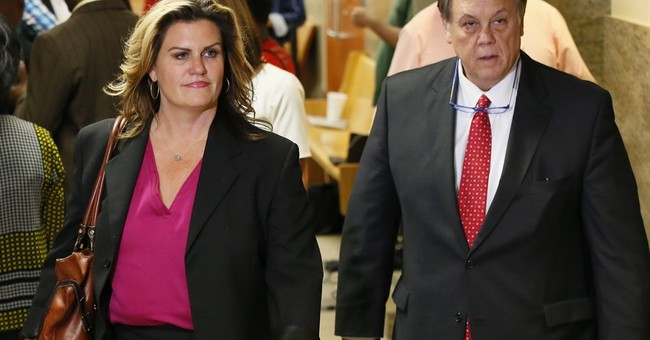 The Latest: Family: Acquitted cop should not return to work