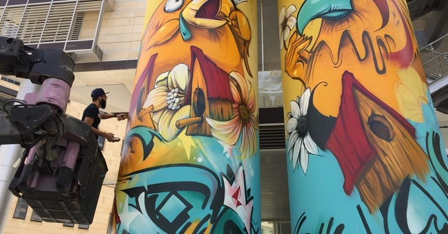From beige to bright: Graffiti livens up Jordan's Amman