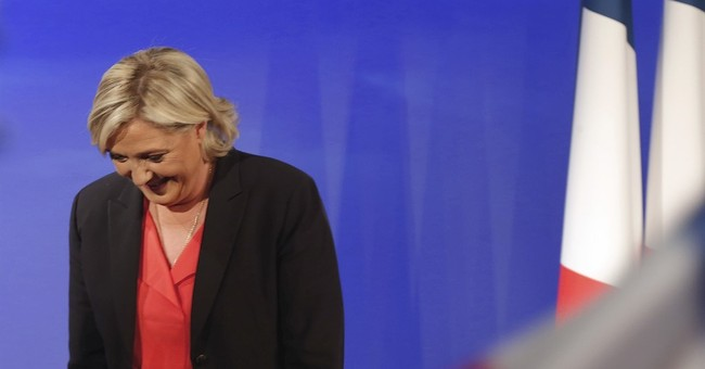 France's Le Pen to run for parliament with party in disarray