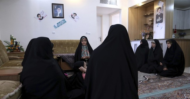 As Iran picks a president, 2 voters, very different views