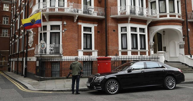 The Latest: Assange hails Swedish move to drop investigation