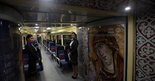 Tensions flare as Serb nationalist train halts at border