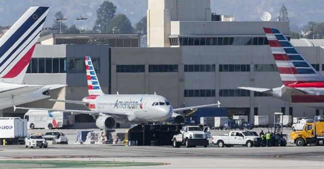 The Latest: Plane clips truck at LA airport, 8 injured