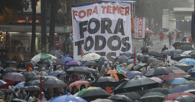 Brazilians call for president to resign after graft charges