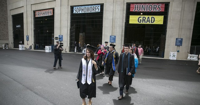 Graduates walk out on Pence at Notre Dame commencement