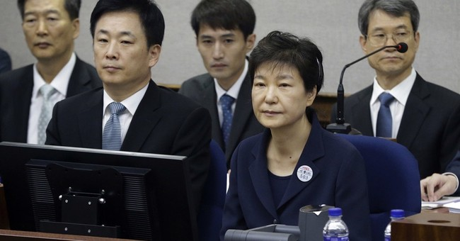 South Korea's Park denies charges as corruption trial begins