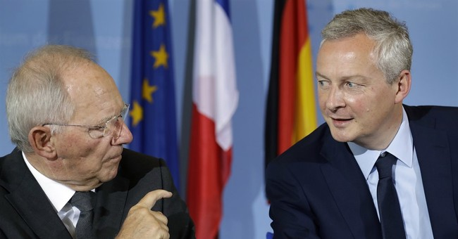 Germany, France pledge new effort to strengthen eurozone class=
