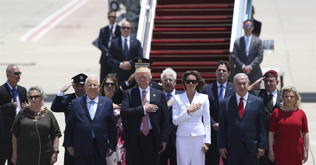 Questions about Russia chase Trump during first Israel visit