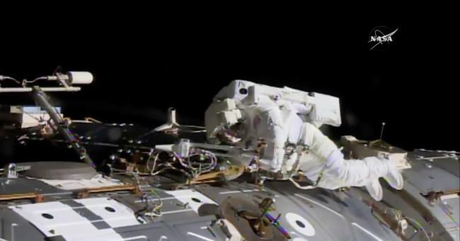 Spacewalking astronauts pull off urgent station repairs