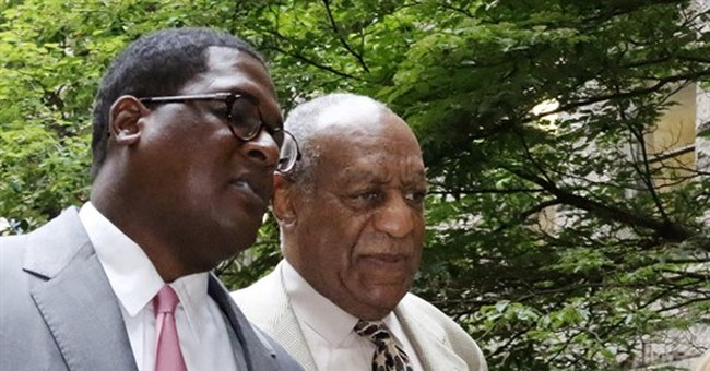 The Latest: Cosby defense alleges race bias in jury strikes