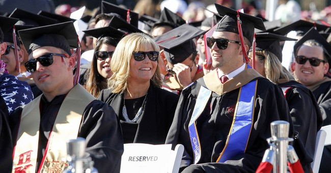 Mom who went to classes with quadriplegic son gets MBA
