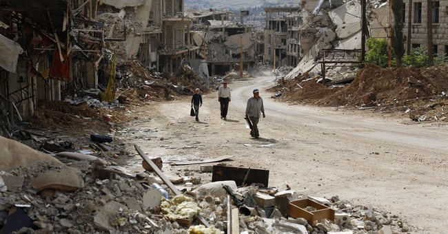 In Syria's devastated twin towns, tears mix with rubble