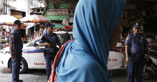 The Latest: Duterte says skirmishes with militants ongoing