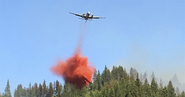 Fire 50 percent contained at Washington state tourism spot