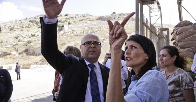 On the Syrian border, Haley confronts civil war's reality