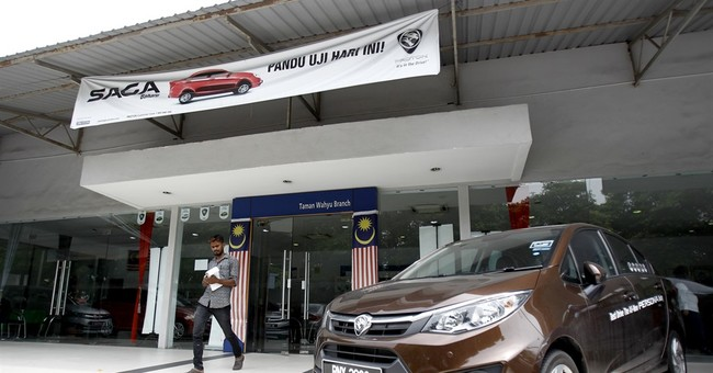 China's Geely buys stakes in Malaysia's Proton, Lotus