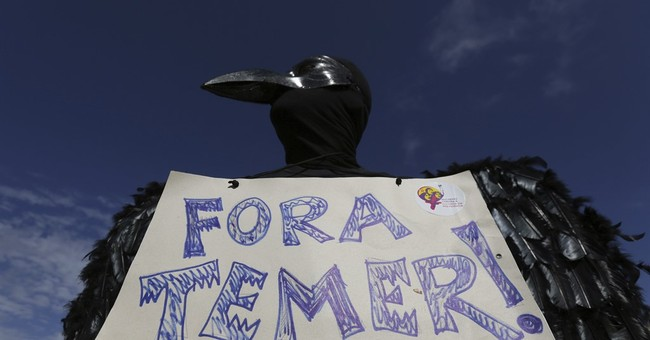 The Latest: Brazil military protects buildings during demos