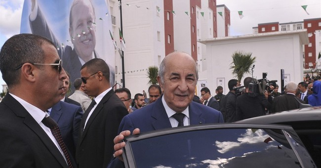 Algeria's president names new prime minister after poll win