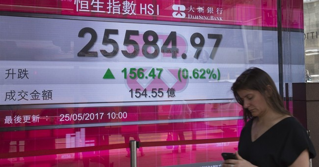 World stocks hit record after Fed minutes; oil rises as OPEC meets