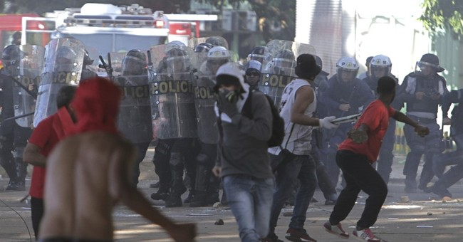 The Latest: Brazil president withdraws troops after clashes