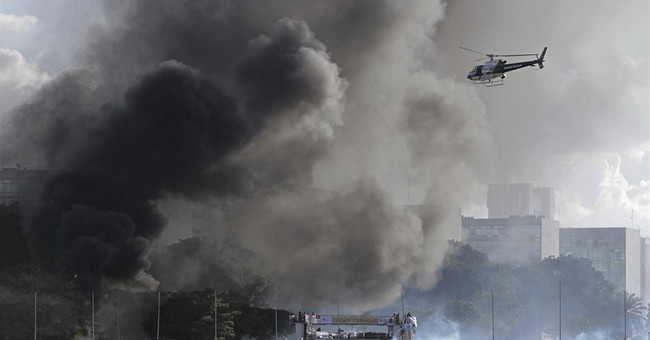 Troops pull out of Brazil capital; president under pressure