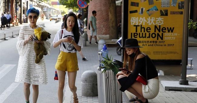 Moody's cuts China rating citing rising debt, slowing growth