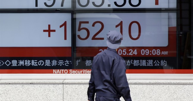Markets brush aside China rating downgrade