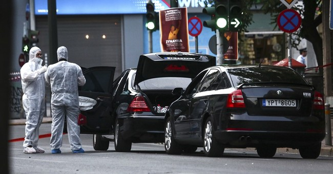 Greek ex-prime minister hurt as letter bomb explodes in car