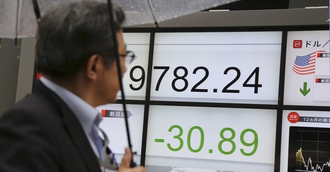Asian shares mixed as oil's fall counters Wall St gains